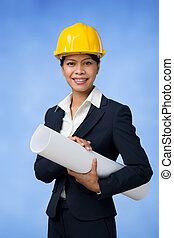 Female engineer - Portrait of pretty female with paper in...