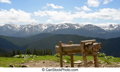 Feeder cattle in mountains. old rusty cattle feeder, on...