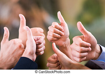 Thumbs up - Human hands showing sign of okay