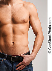 Masculine body - Torso of strong man wearing jeans in...