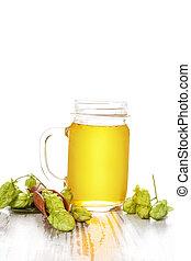 Hop lemonade. - Beer lemonade in glass with hop in scoop on...