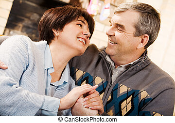 Happy couple - Portrait of happy senior couple looking at...