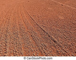 Footprints and service marks on a outside tennis court,...