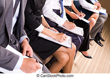 Business education - Photo of row of business people making...