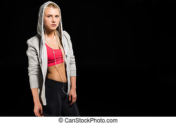 woman in sports clothing - portrait of woman in sports...
