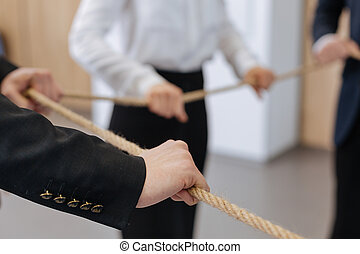 Close up of male hand holding the rope