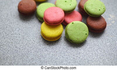 colored macaroon cookies going to a bunch on a table