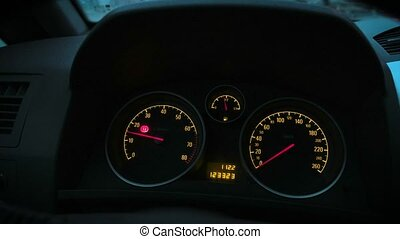 The speedometer of the car shows the engine speed 4k