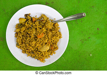 Pilau on white plate, Kenya - Pilau on white plate on green...