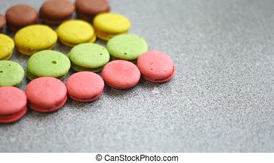 on the table lay a colored macaroon cookies in line close up