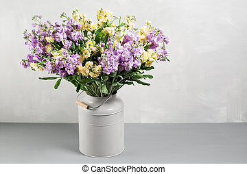 Bouquet of lilac and lemon color flowers gillyflower in grey...