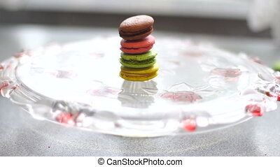 macaroon cookies and coffee on a plate