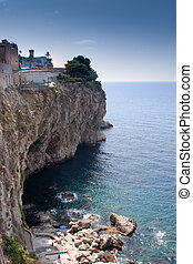 Sea of Sicily; Taormina seascape with steep rocky cliffs....