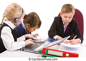 Children working - Photo of busy girls interacting at...