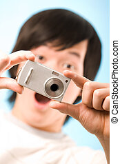 Fantastic snapshot - Image of photo camera in surprised guy...