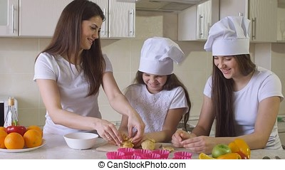 Sisters with Mom Spending Time in Kitchen.