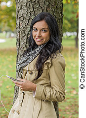 woman listens to music on mobile phone - a young woman...