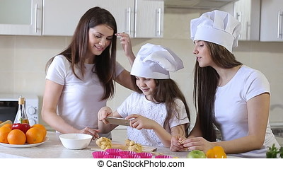 Happy Family is Cooking in The Kitchen.