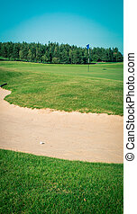 sand trap on a golf course - Sand trap on a golf course in...