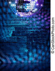 Mirror ball lights on dramatic dark disco brick wall