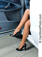 Pretty woman in car - Young lady get out of the car