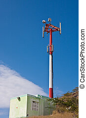 Red and White Communication Tower on Hill