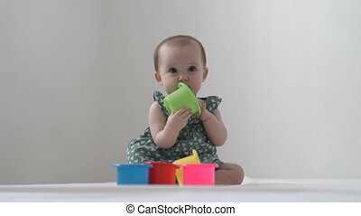 Little girl is playing with toys