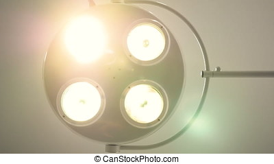 Surgical lamp switching on and off. Medical concept. 4K. -...