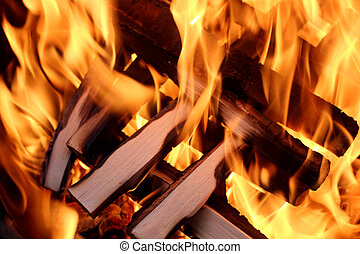Fire and flame four - Charred wood and bright flames on dark...