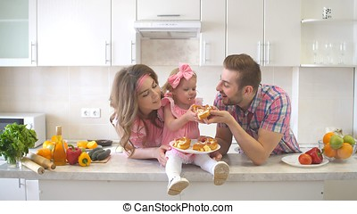 Happy Family Eating Cake in the Kitchen