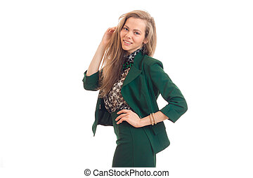 beautiful young girl with blond hair smiling and posing for the camera in a green suit