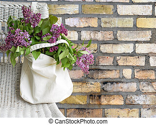 lilac bouquet in sack on chair - lilacs in muslin cotton bag...
