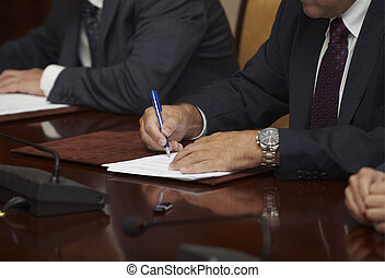 signature signing contract office business - close up of...