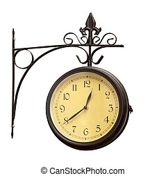old grunge antique wall clock - close up of an old antique...