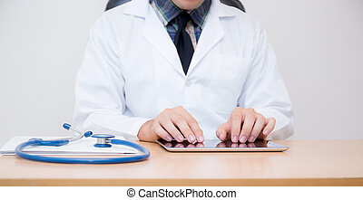 male doctor with tablet computer and stethoscope at the desk on white background.