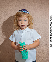 Little boy with long blond curls - Adorable Jewish child in...