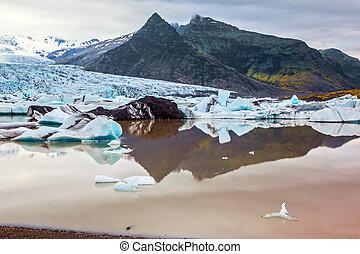 Grandiose glacier of Iceland Vatnajokull in beams of a...