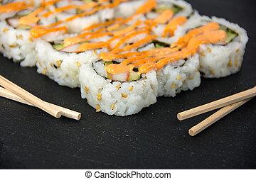 sushi on black slate