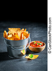 Crispy nachos with tomato dip and coriander