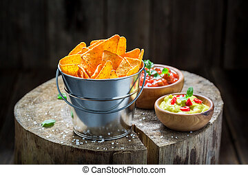 Mexican nachos with tomato dip and coriander