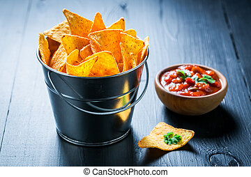 Delicious nachos with tomato dip and coriander