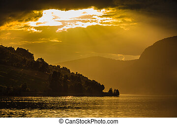 Red sunset over sea fjord Norway - Tourism vacation and...