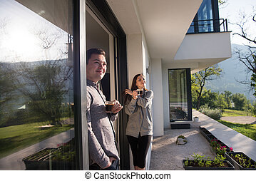 couple enjoying on the door of their luxury home villa -...