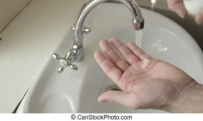 Man lathers and washes his hands. Cleaning Hands with sprays...