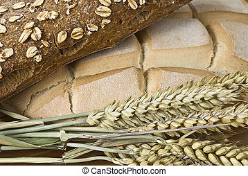 Bread 12. - Some bread and cereals on a bamboo mat.