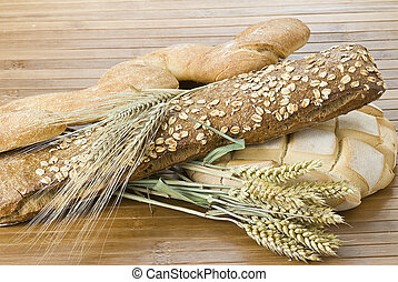 Bread 10 - Some bread and cereals on a bamboo mat