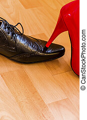 lady's slipper occurs men's shoe - a woman steps on a man...
