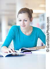 pretty young college student in a library (shallow DOF;...