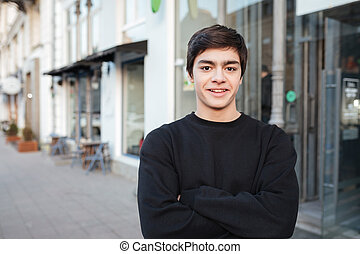 Young man looking camera in the street