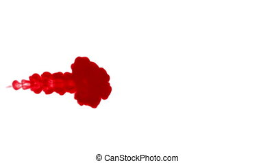 Close-up shot of a drop ink in liquid. Red dye in water and...